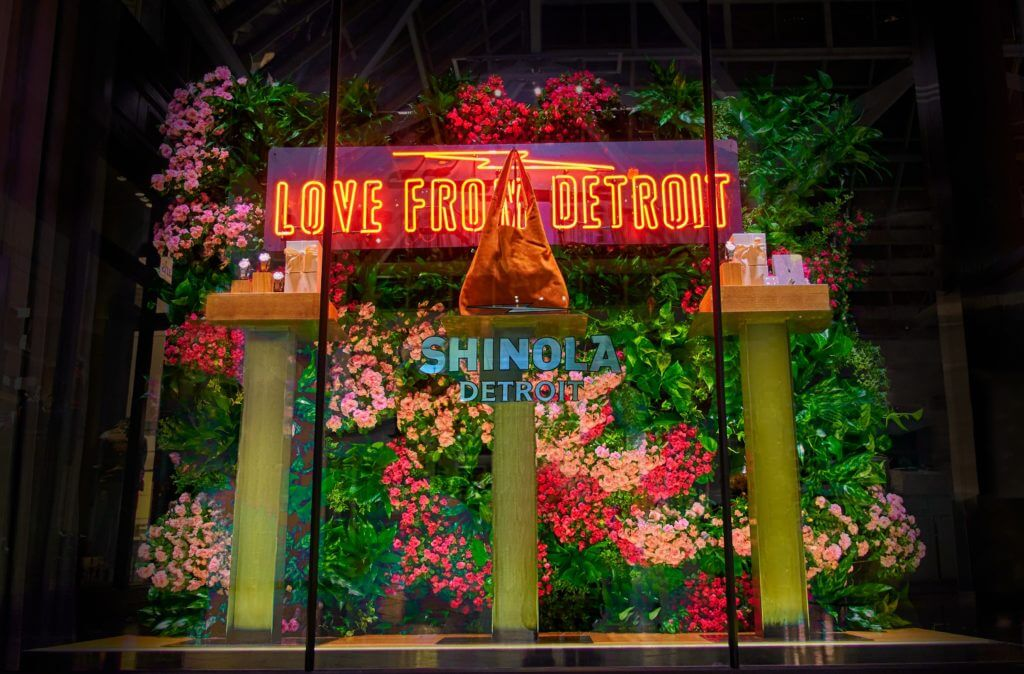 Shinola goods in front of Boston living wall
